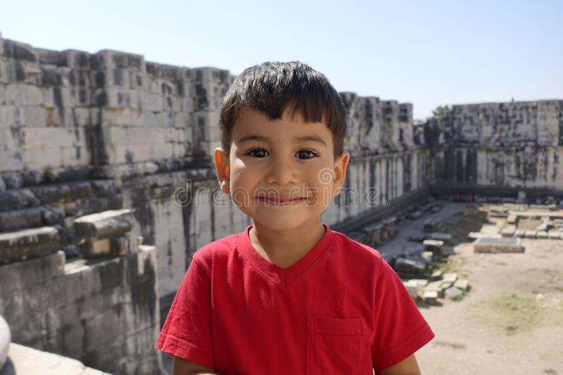 Portrait of smiling boy in the temple of Apollo. royalty free stock image