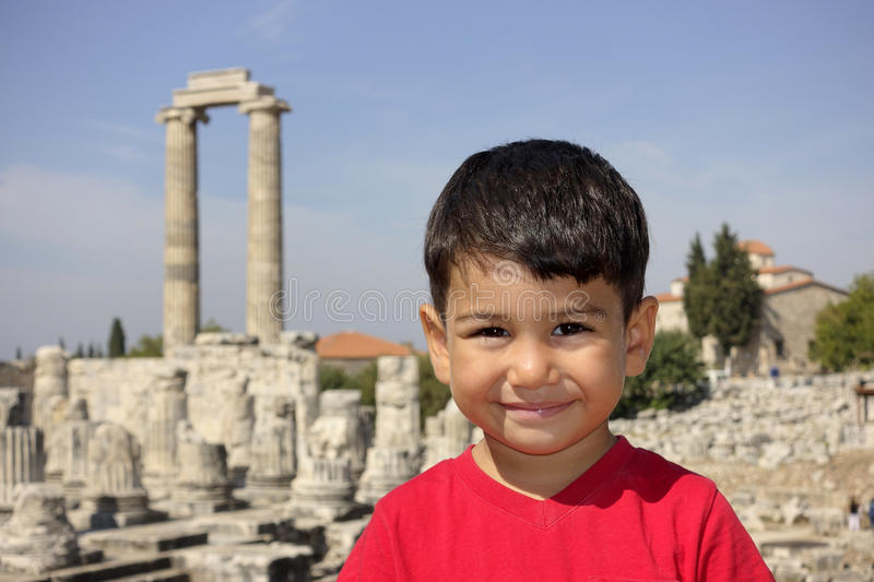 Portrait of smiling boy in the temple of Apollo. High Res royalty free stock image