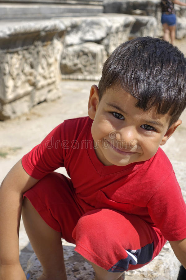 Portrait of smiling boy in the temple of Apollo. stock images