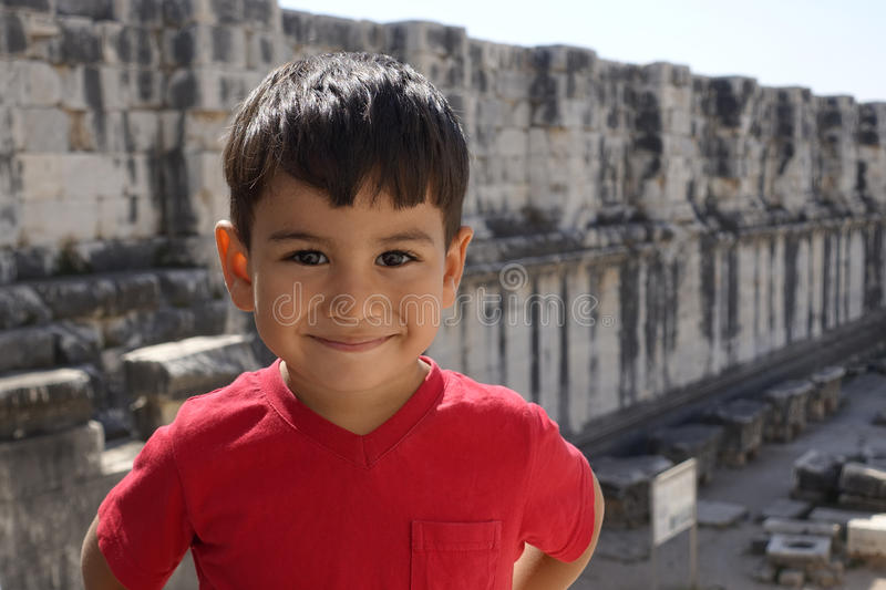 Portrait of smiling boy in the temple of Apollo. royalty free stock photography