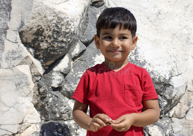 Portrait of smiling boy in the temple of Apollo. stock image
