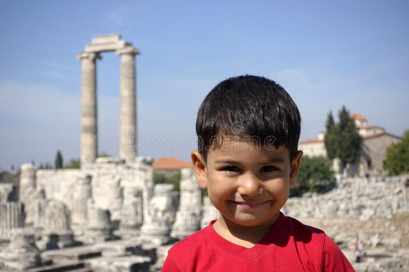 Portrait of smiling boy in the temple of Apollo. royalty free stock images