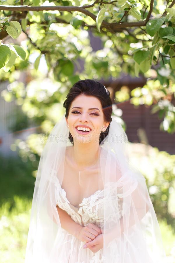 The portrait of a smiling bride stock image