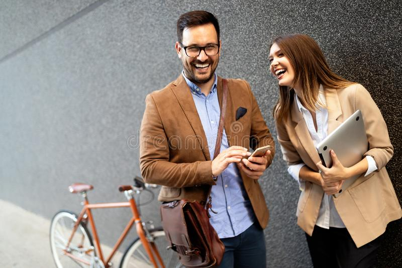 Portrait of happy smiling business people talking in the city royalty free stock image