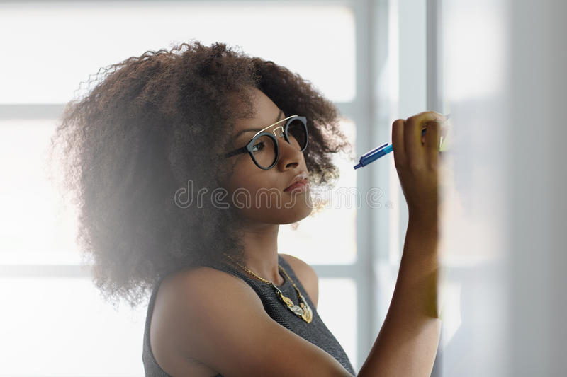 Portrait of a smiling business woman with an afro royalty free stock image