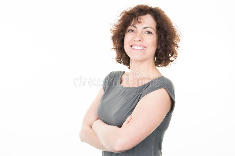 Portrait of smiling business woman with crossed arms curly hairs royalty free stock photos