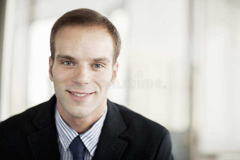 Portrait of smiling businessman, head and shoulders royalty free stock photos