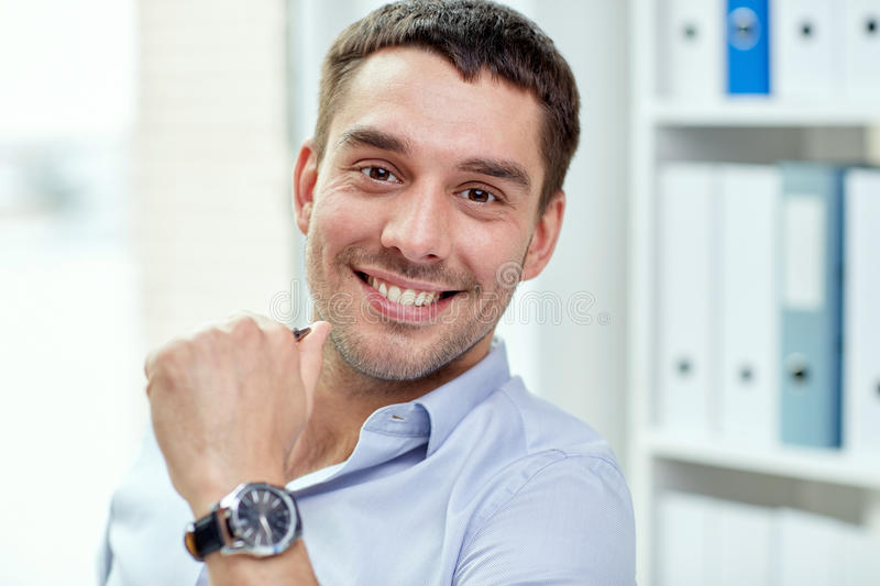 Portrait of smiling businessman in office royalty free stock photo