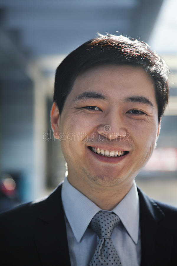 Download Portrait Of Smiling Businessman In A Parking Garage Stock Photo - Image: 36767278
