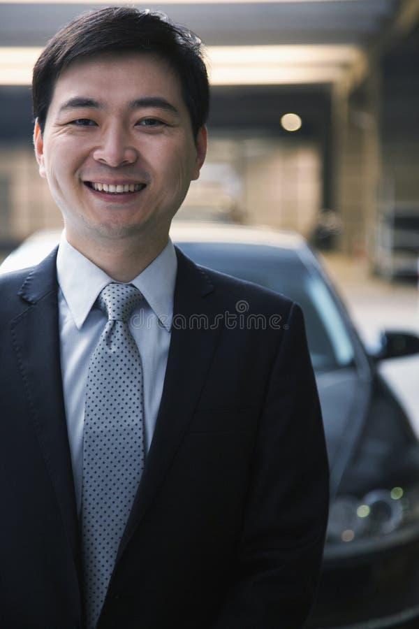 Download Portrait Of Smiling Businessman In A Parking Garage Stock Image - Image: 36767313