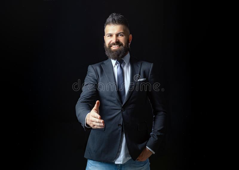 Portrait of smiling businessman shaking hands. Man professional possibly accountant architect businesswoman lawyer stock image