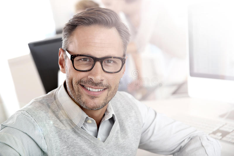 Portrait of smiling businessman at work stock photo