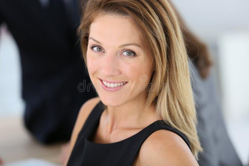 Portrait of smiling businesswoman stock image