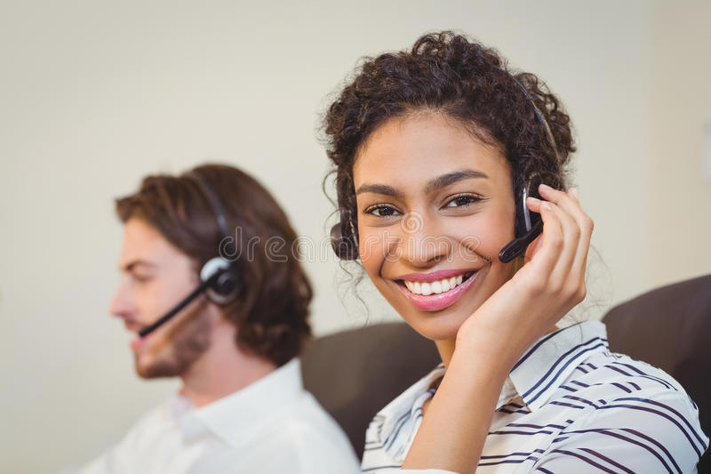 Portrait of smiling businesswoman in call center stock images