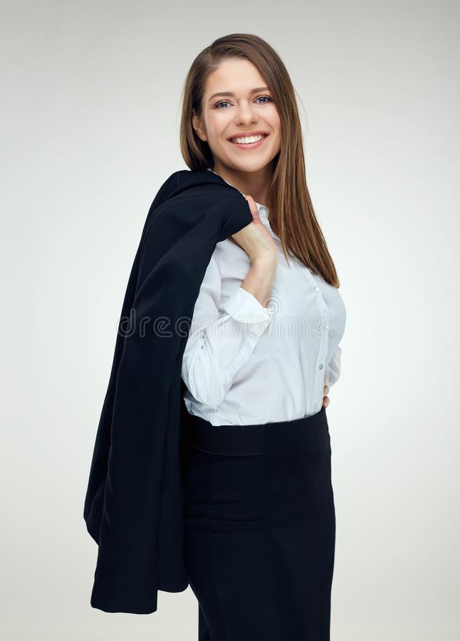 Portrait of smiling businesswoman holding black suit jacket on s. Houlder. Isolated on white royalty free stock photo