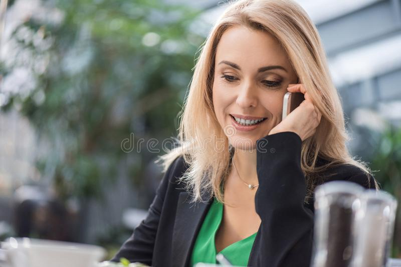 portrait of smiling businesswoman talking stock photos