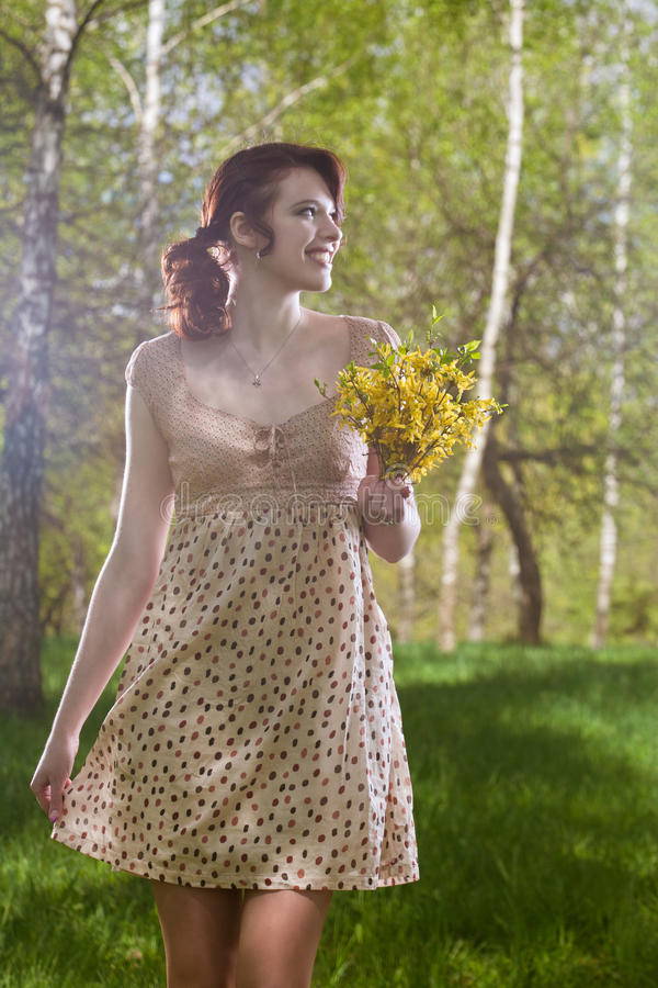 Download Portrait Of Smiling Caucasian Girl With Flowers Stock Image - Image: 19954231