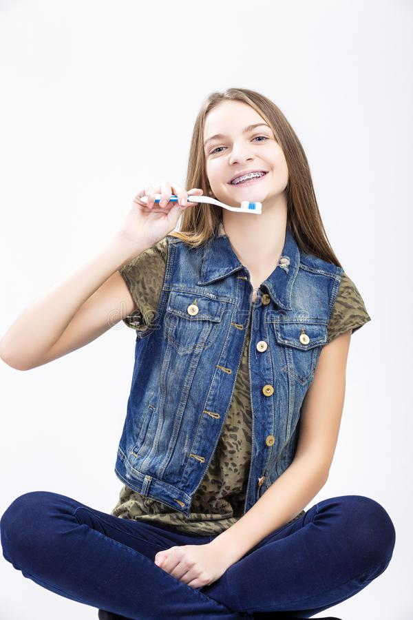 Portrait of Smiling Caucasian Teenage Girl. Dental Health Concepts. Portrait of Smiling Caucasian Teenage Girl with Teeth Brackets. Posing with Toothbrush stock image