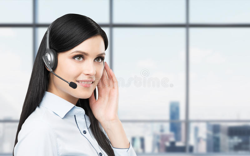 Portrait of smiling cheerful support phone operator in headset. stock images