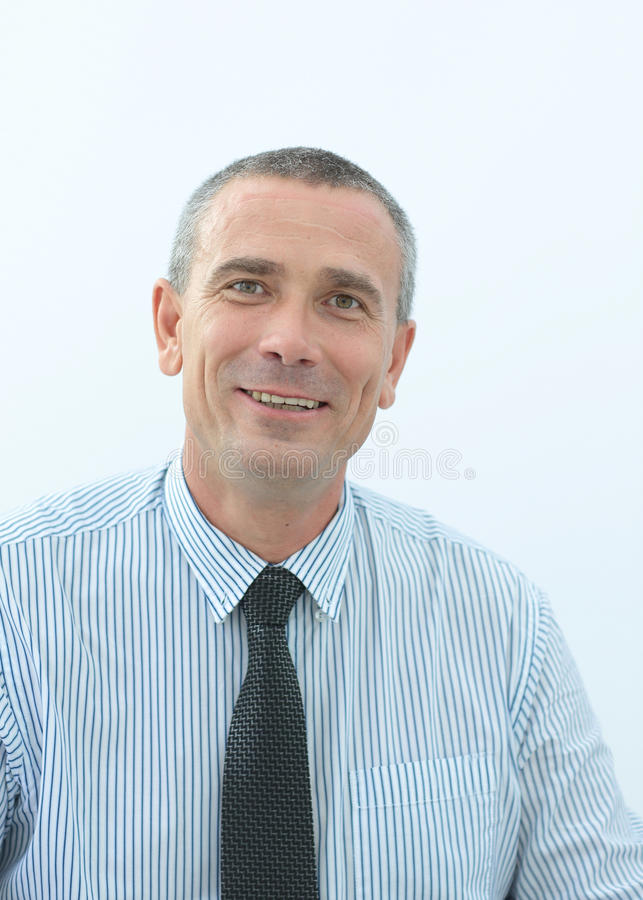 Portrait of a smiling and confident Mature businessman in shirt stock photo