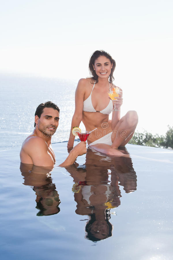 Download Portrait Of A Smiling Couple Having A Cocktail Stock Image - Image: 22236623