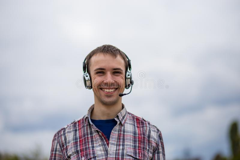Portrait of a smiling customer service operator wearing a headset stock images