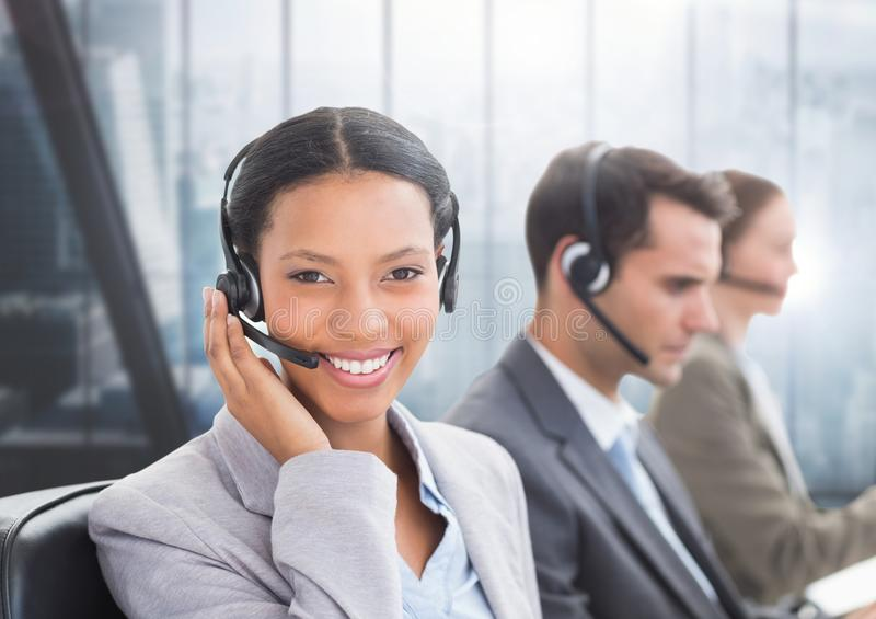 Portrait of smiling customer service woman talking on headset stock images