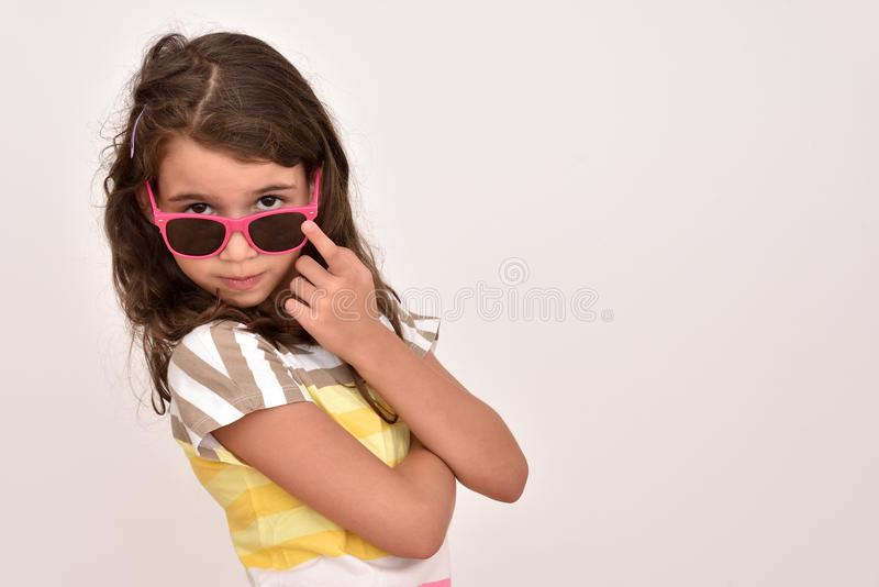 Smiling cute young girl with sunglasses royalty free stock photo