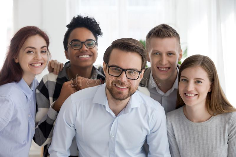 Portrait of smiling diverse millennial team posing together stock photo