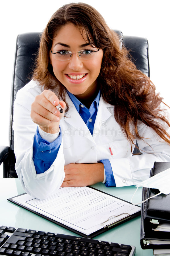 Portrait Of Smiling Doctor Pointing With Pen Royalty Free Stock Images