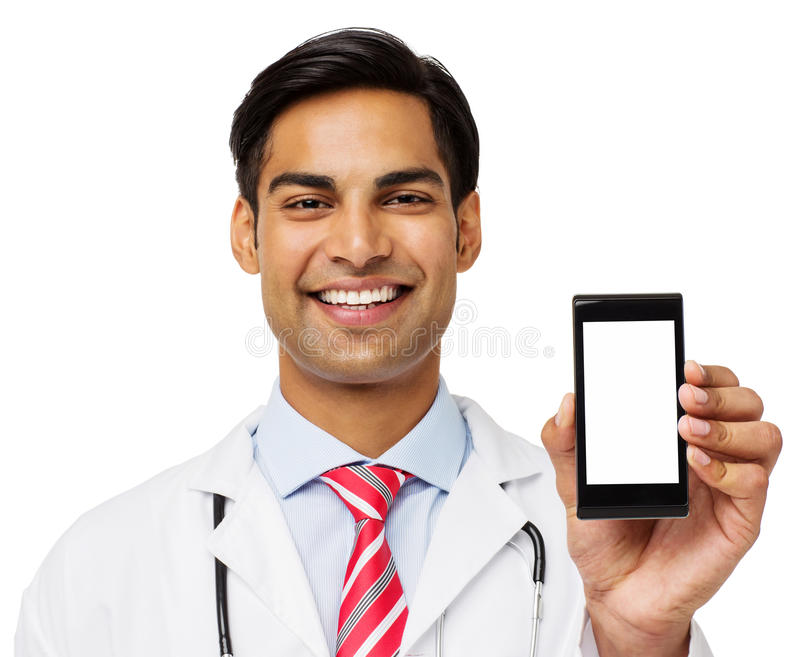 Portrait Of Smiling Doctor Showing Smart Phone. Portrait of smiling male doctor showing smart phone over white background. Horizontal shot stock image