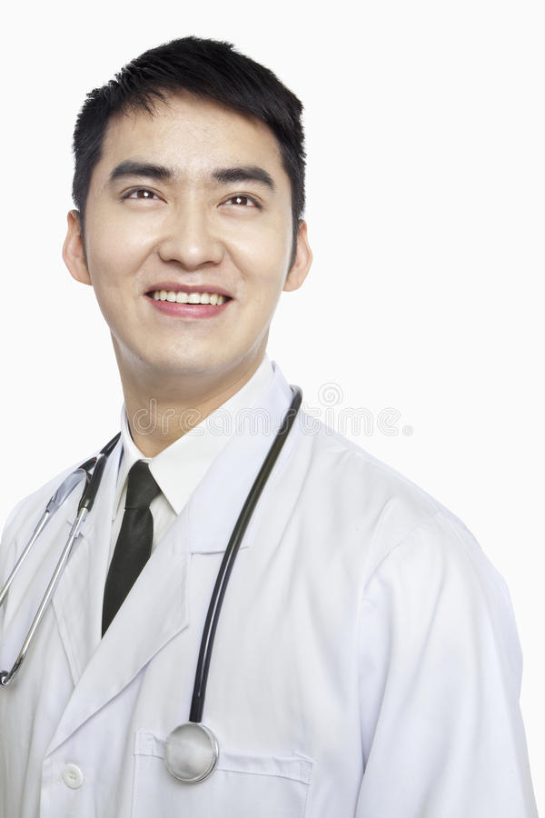 Portrait of Smiling Doctor with Stethoscope Around Neck, Studio Shot, Looking Up stock photography