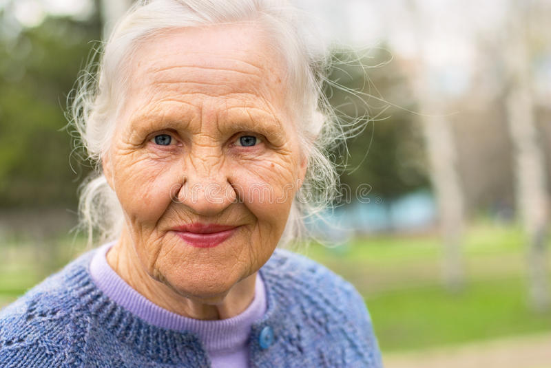 Portrait smiling elderly woman stock images