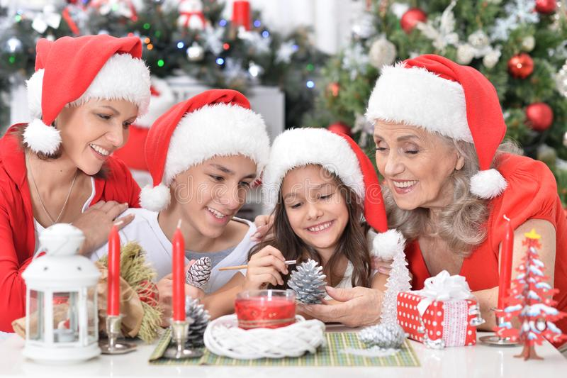 Portrait of cute smiling family celebrating Christmas together stock photos