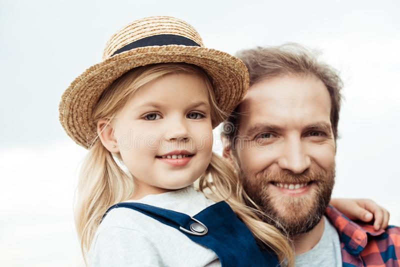 Portrait of smiling father and little daughter looking. At camera stock photography
