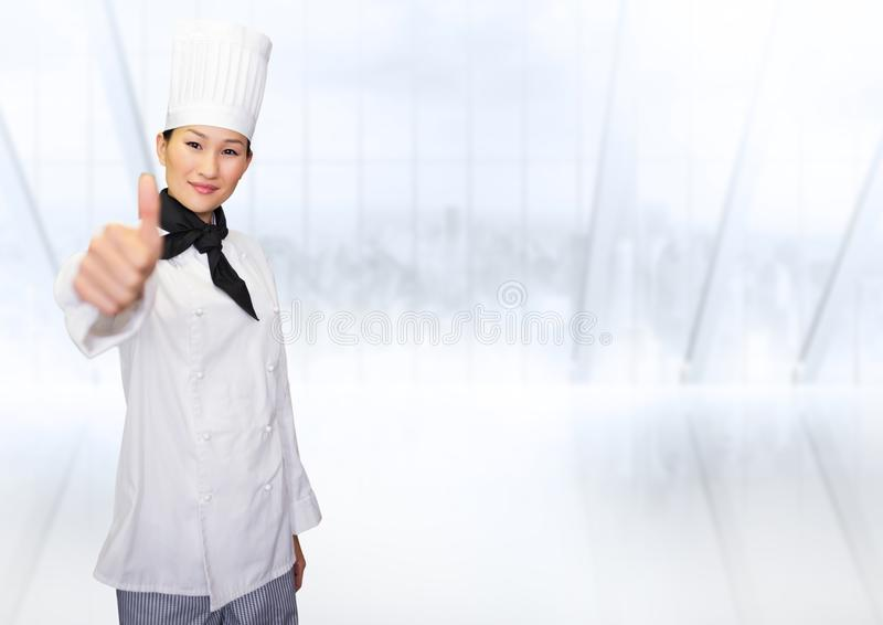 Portrait of smiling female chef cook showing thumbs up stock images