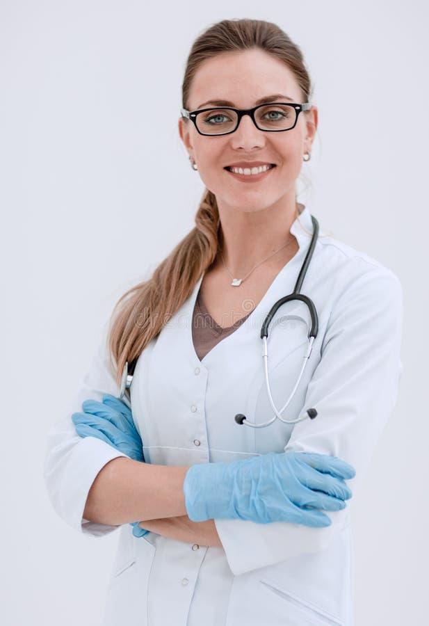 Portrait of smiling female doctor on light background stock photo
