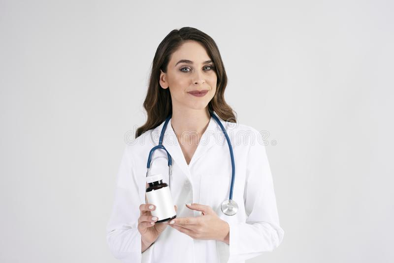 Portrait of smiling female doctor with stethoscope and medicament royalty free stock image