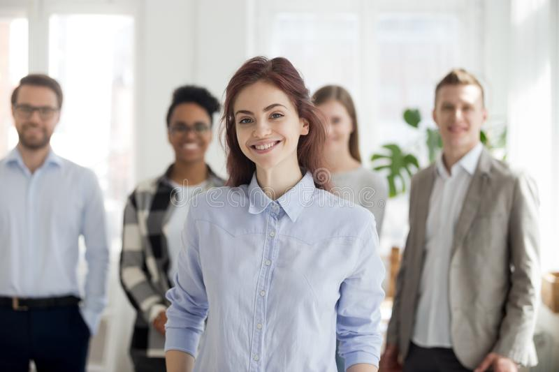 Portrait of smiling female employee foreground posing for pictur stock images