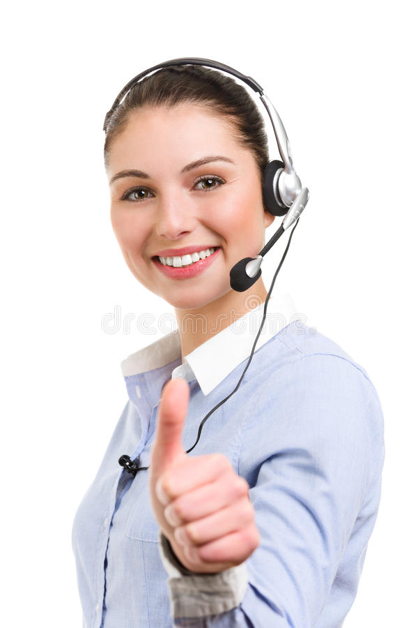 Portrait of smiling female phone operator in ok gesture stock photo