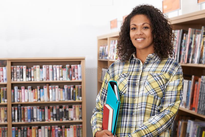 Portrait Of Female Student Studying In Library royalty free stock photo