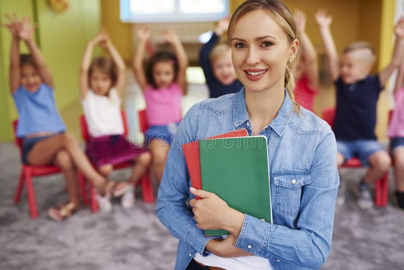 Portrait of smiling female teacher stock photo