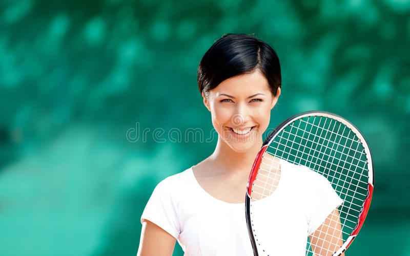 Download Portrait Of Smiling Female Tennis Player Stock Photo - Image of brunette, color: 26637398
