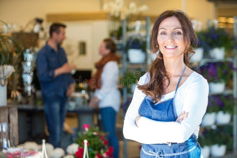 Portrait Of Smiling Florist At Flower Shop stock photos