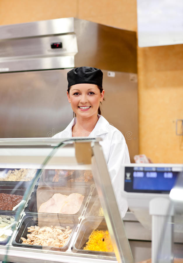Portrait of a smiling food retailer. In her shop royalty free stock images