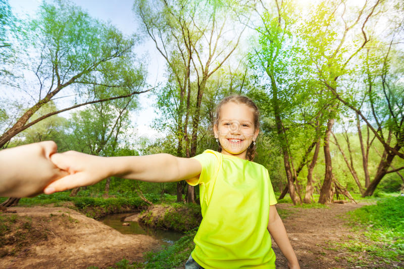 Portrait of smiling girl having fun in the forest royalty free stock photos