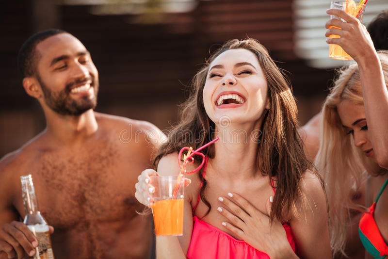Portrait of a smiling girl having fun at pool party stock photos