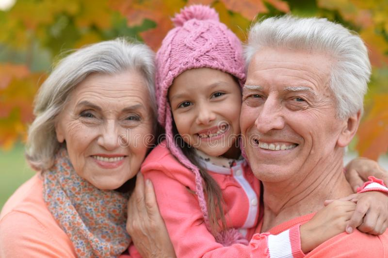 Grandparents and granddaughter in park royalty free stock photography
