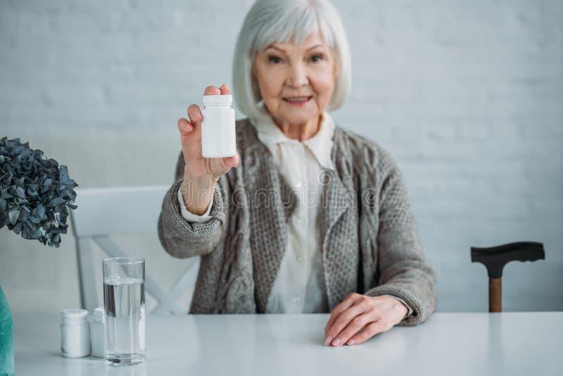 portrait of smiling grey hair woman stock photos