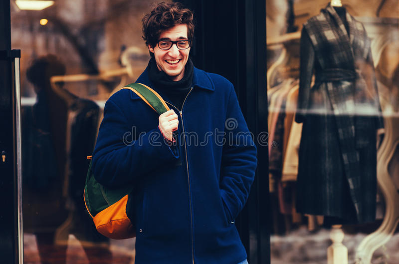 Portrait of a smiling handsome man holding bag stock photography